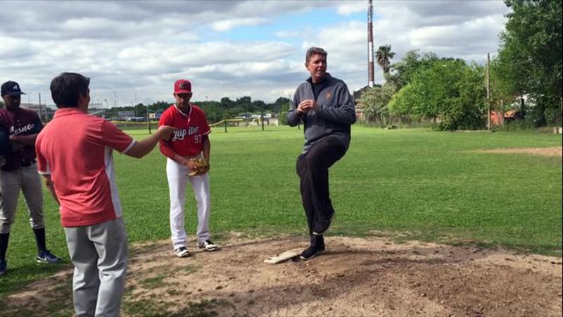 Joel Bradley instructing baseball players in Argentina